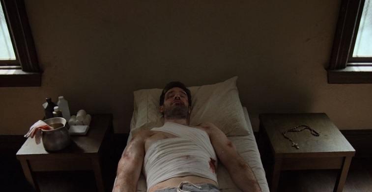 Matt lays in bed injured