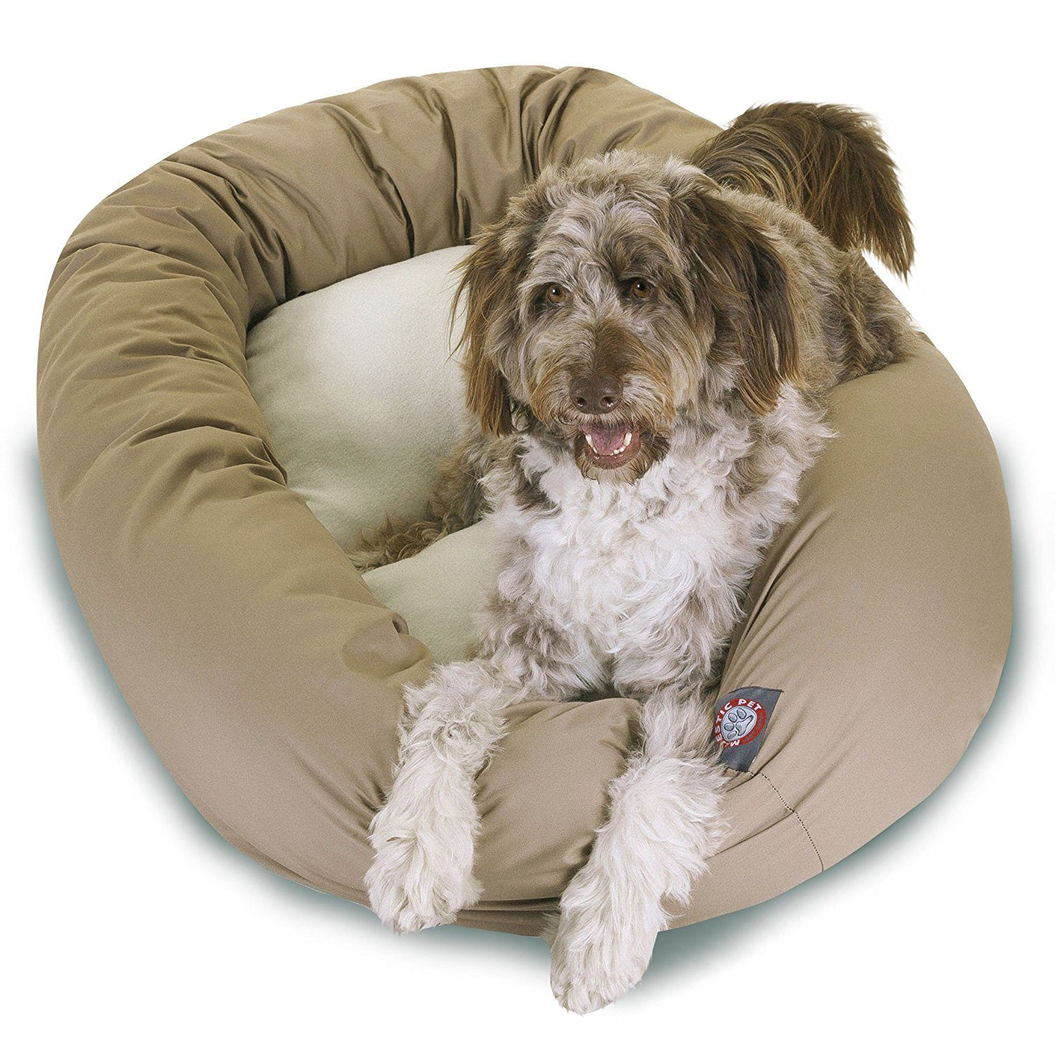 Tan dog bed with dog