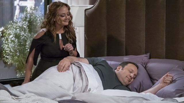 Leah Remini stands over Kevin James while he lays in bed in Kevin Can Wait