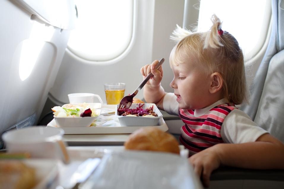 child eating in the airplane