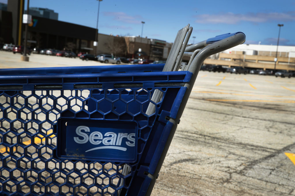 A shopping cart abandoned at Sears.