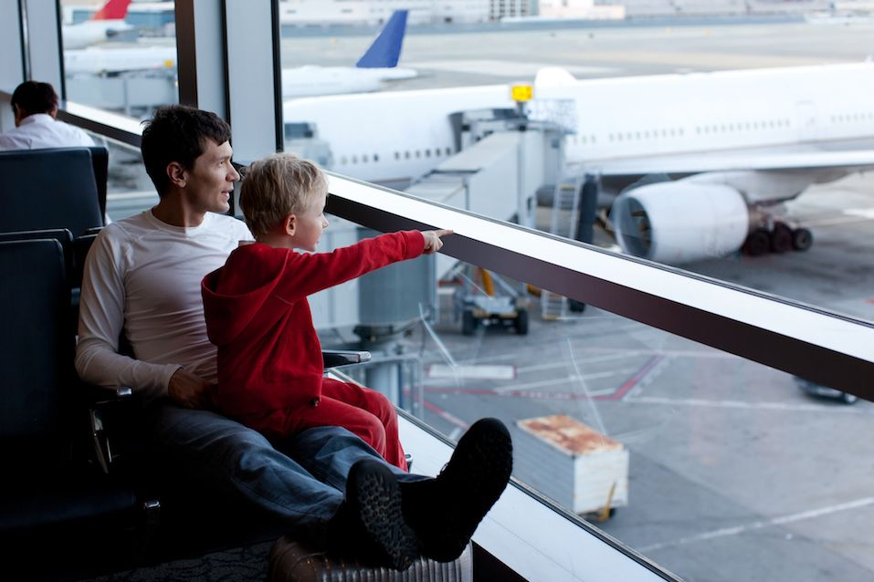 family of two at the airport enjoying time