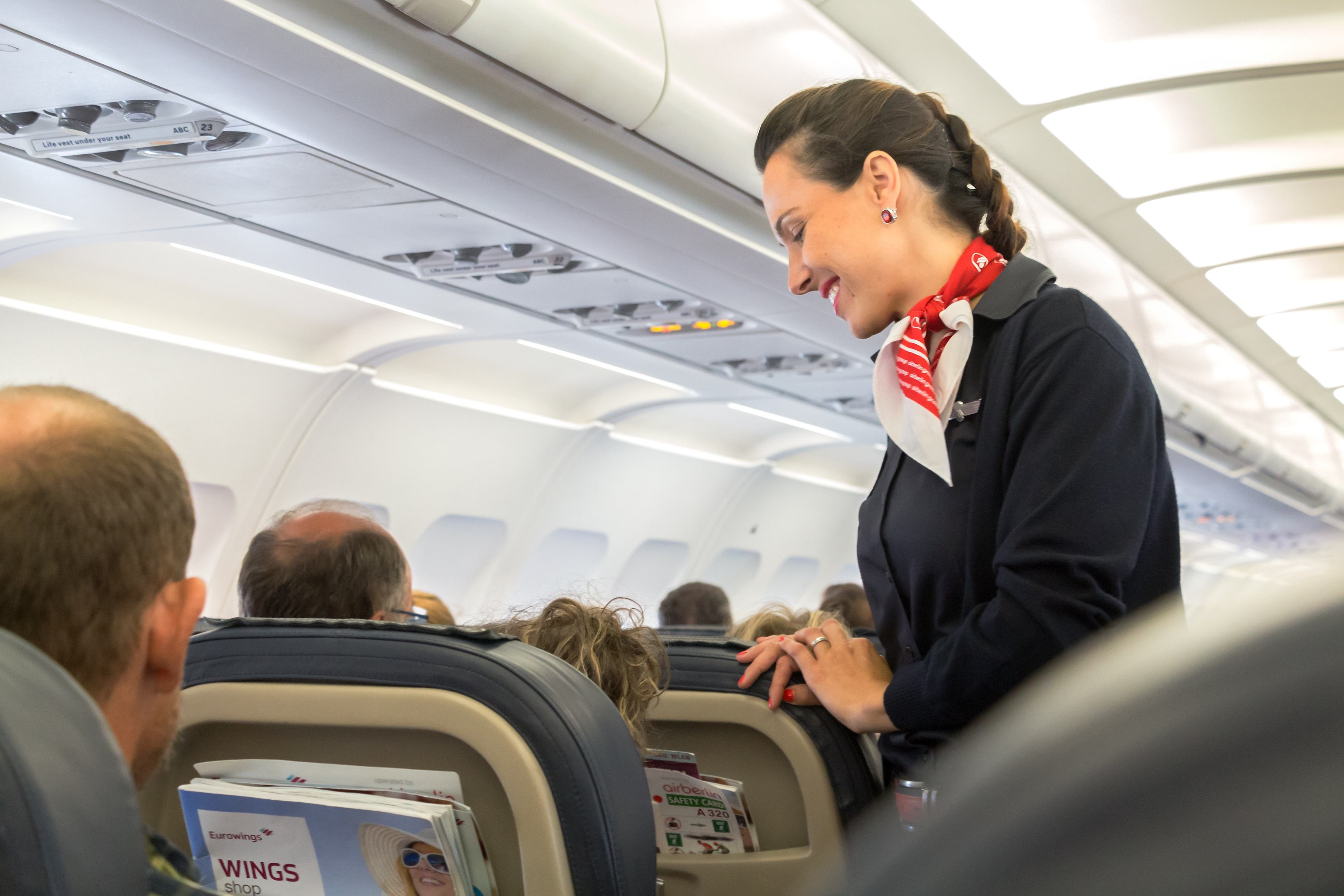 Stewardess talking to passenger