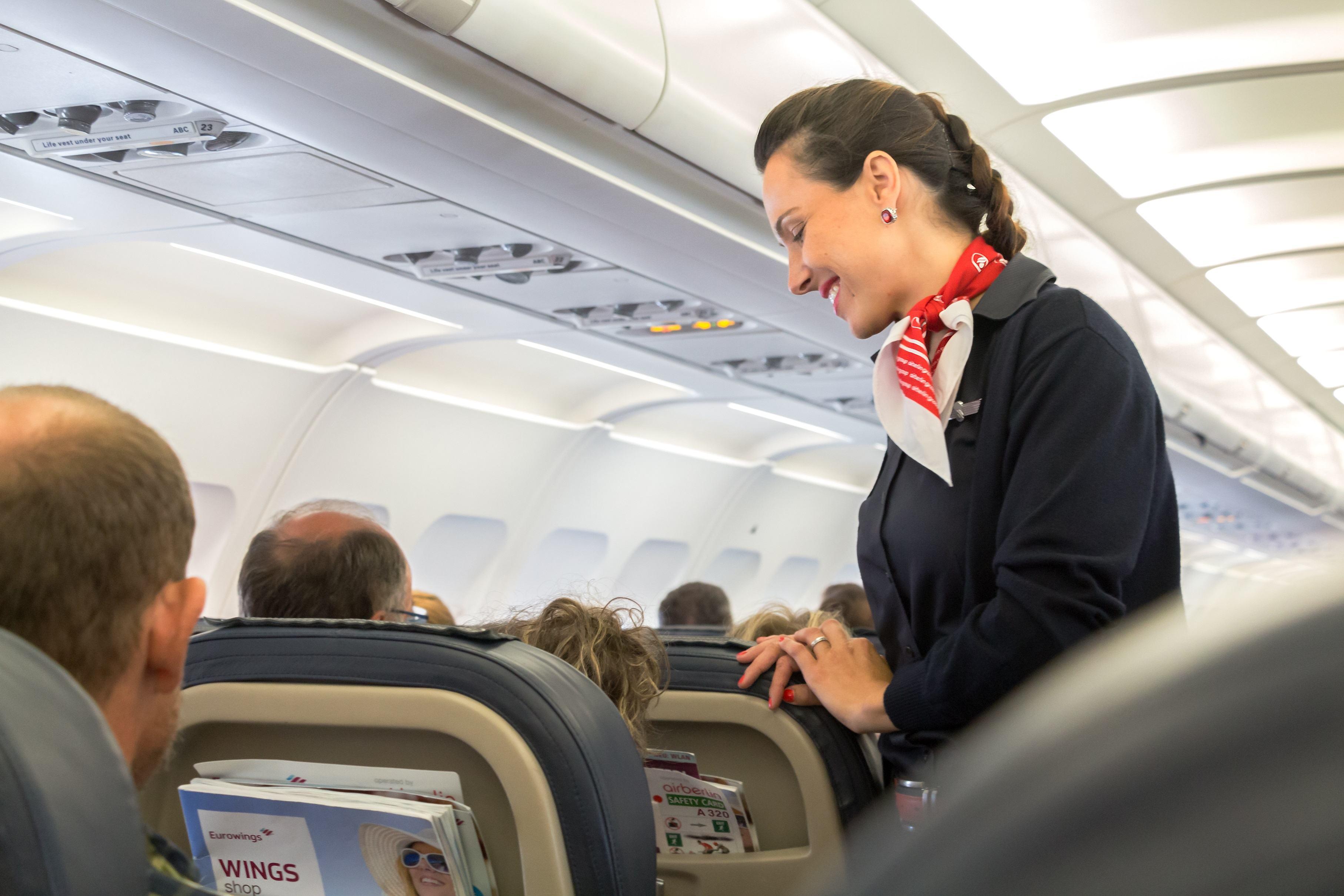 Stewardess talking to passenger