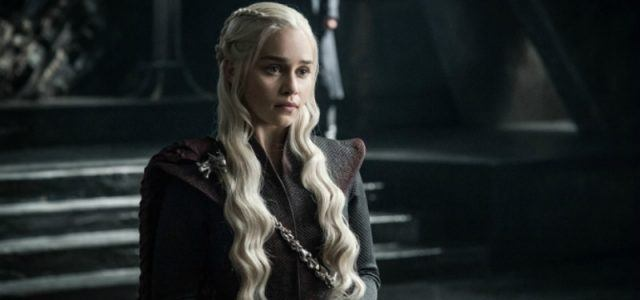 Daenerys Targaryen stands before her throne.