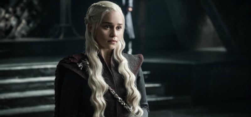 Daenerys Targaryen stands before her throne.