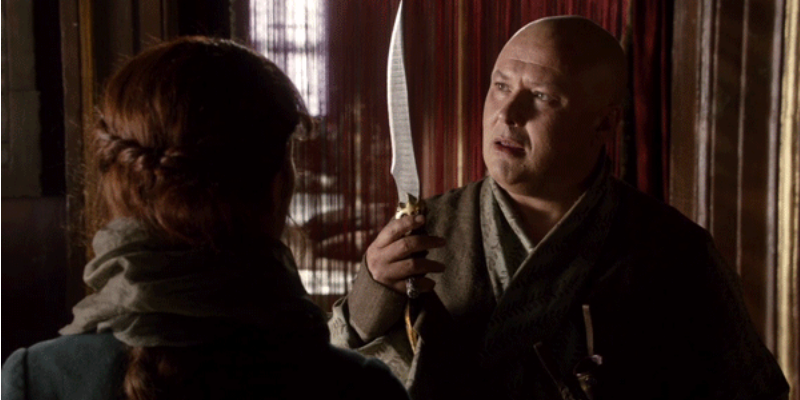 Varys holds up a dagger as he talks to Catelyn Stark.