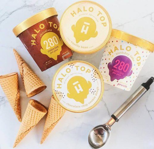 Halo Top ice cream pictured with an ice cream scoop and cones
