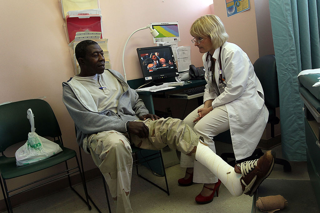 A doctor and patient discuss an injury.