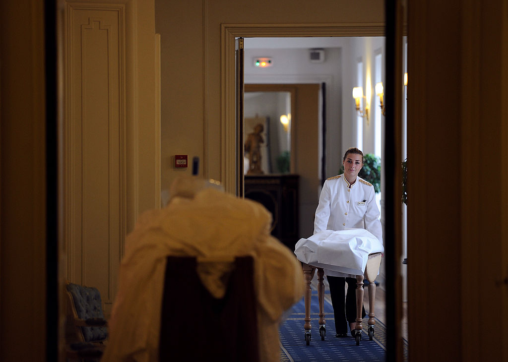 A maid changing linens