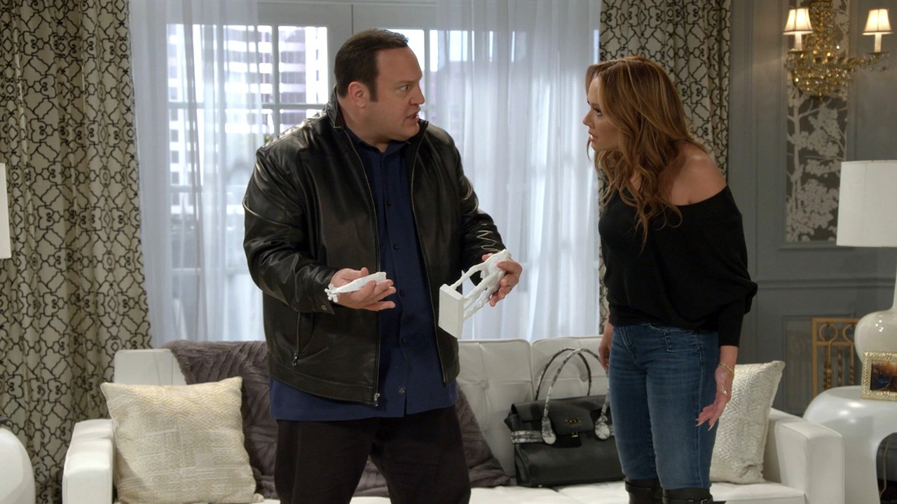 Kevin James looks at Leah Remini in dismay while holding a broken item on Kevin Can Wait