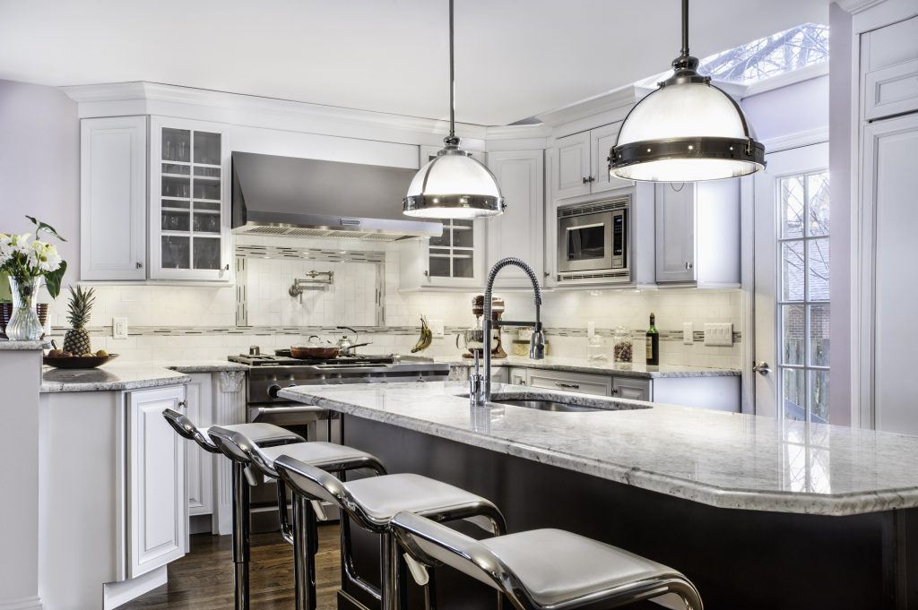 Kitchen with pendant lighting and stools