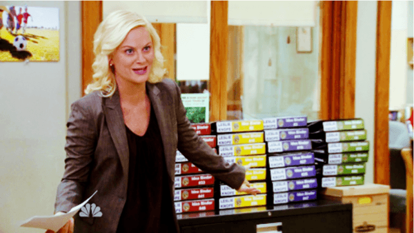 Leslie Knope with binders