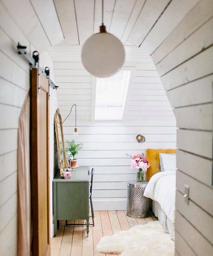 bedroom covered in shiplap