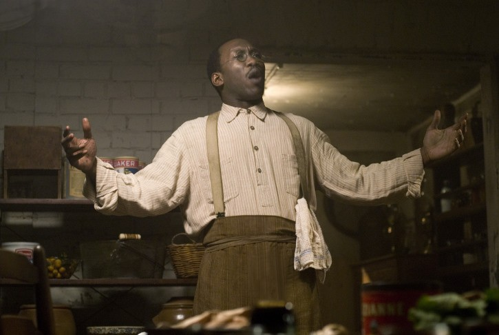 Mahershala Ali holds out his hands in The Curious Case of Benjamin Button