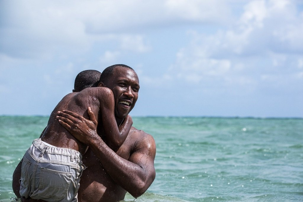 Mahershala Ali carrying a child in the ocean in Moonlight