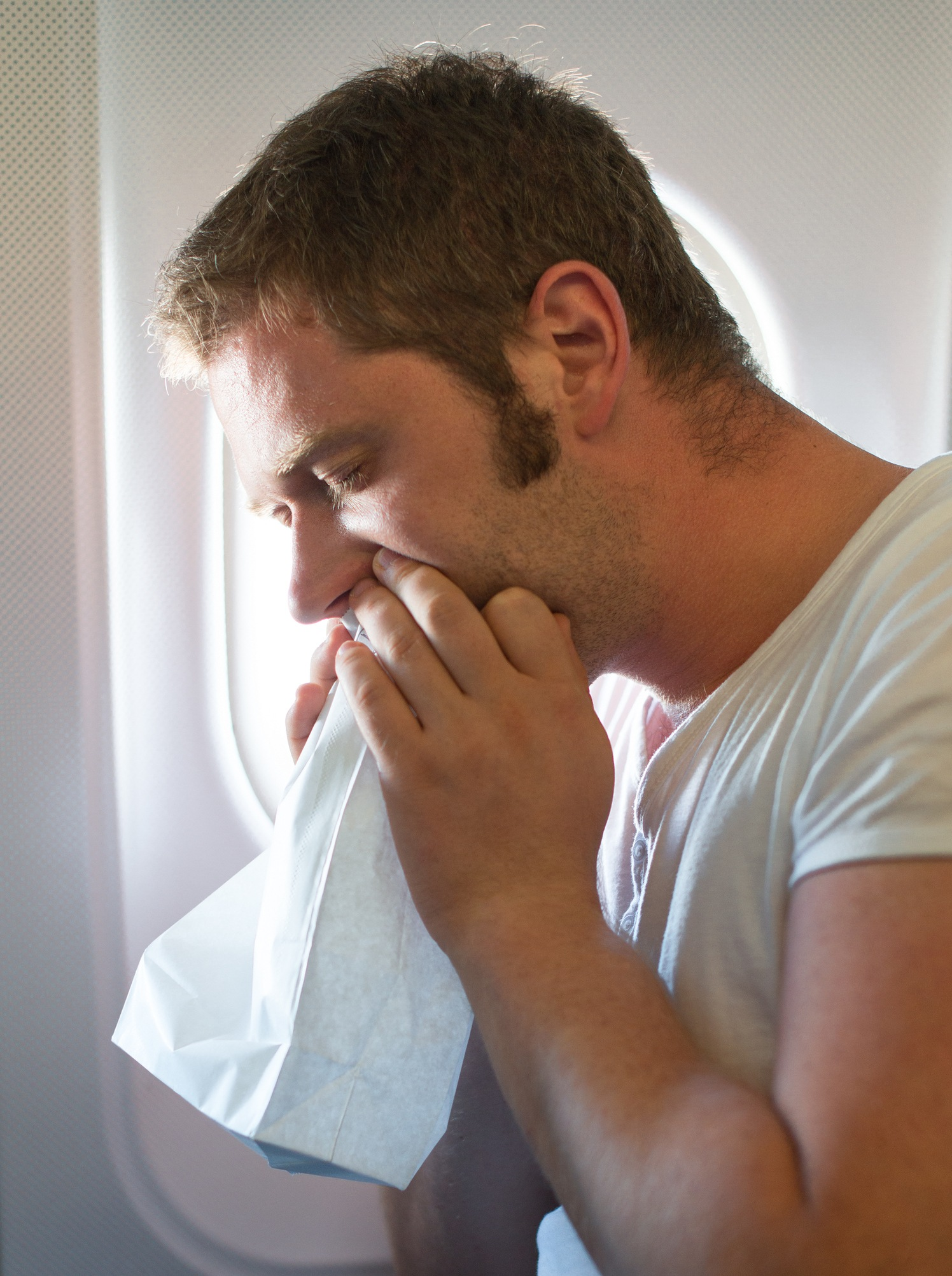 Man throwing up on an airplane