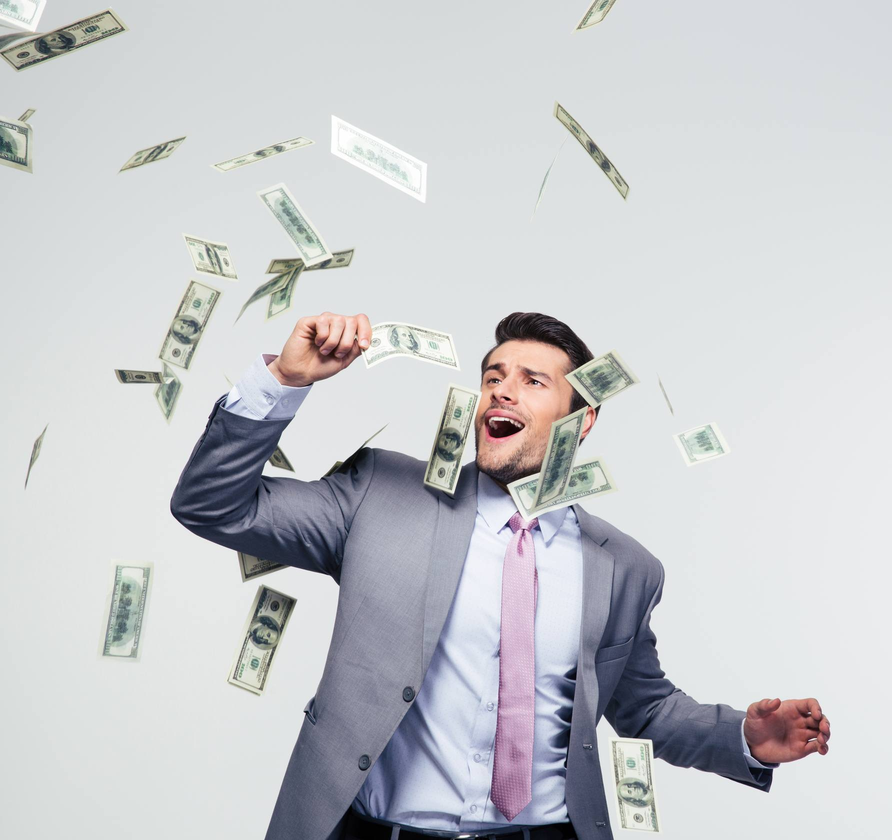 Man in suit with falling money