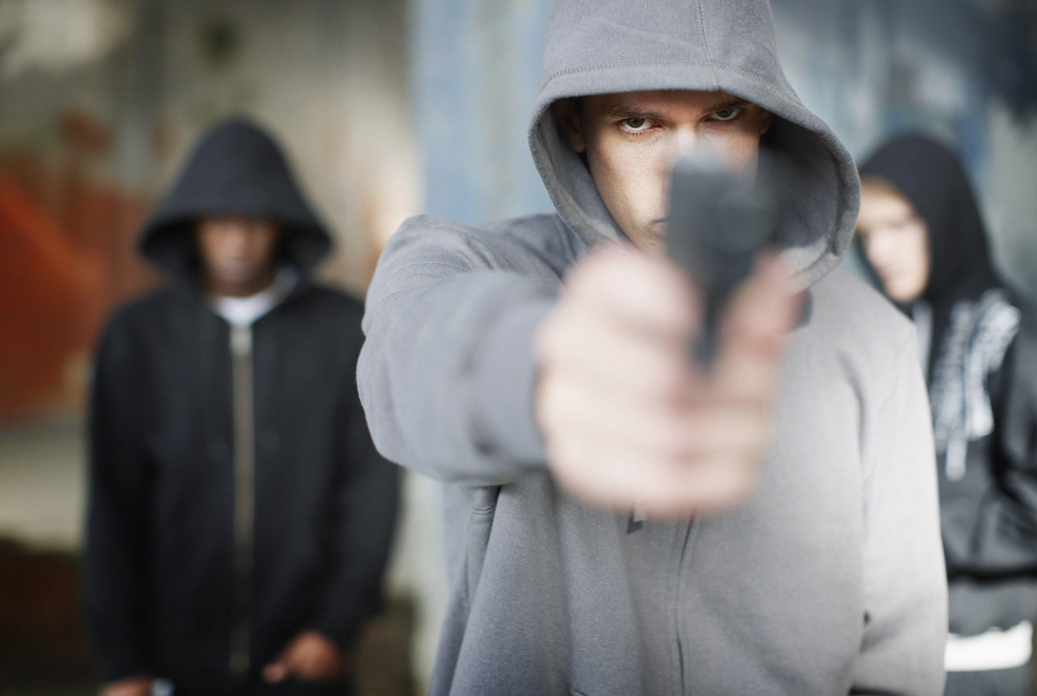 Man pointing gun