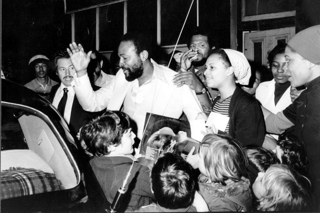 Marvin Gaye gets mobbed by fans while entering a car in London in 1976.