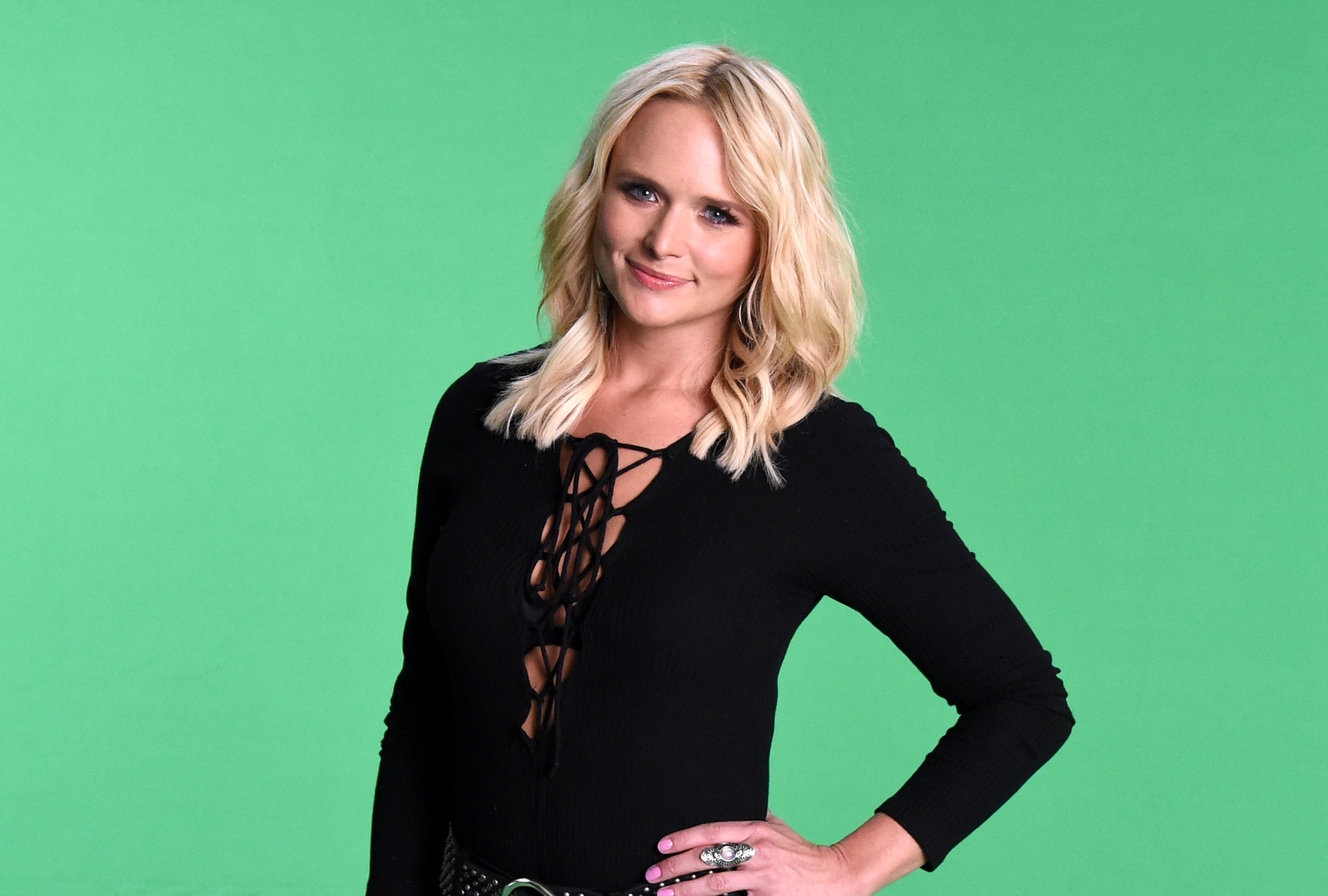 Singer Miranda Lambert poses in front of a green background at the 2016 iHeartCountry Festival