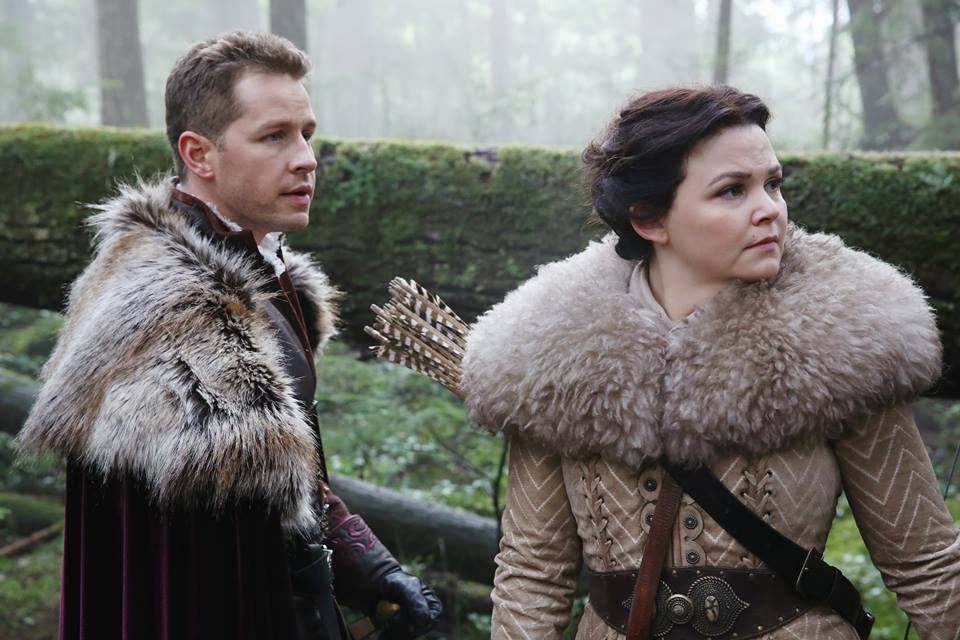Prince Charming and Snow White stand together and look to the side