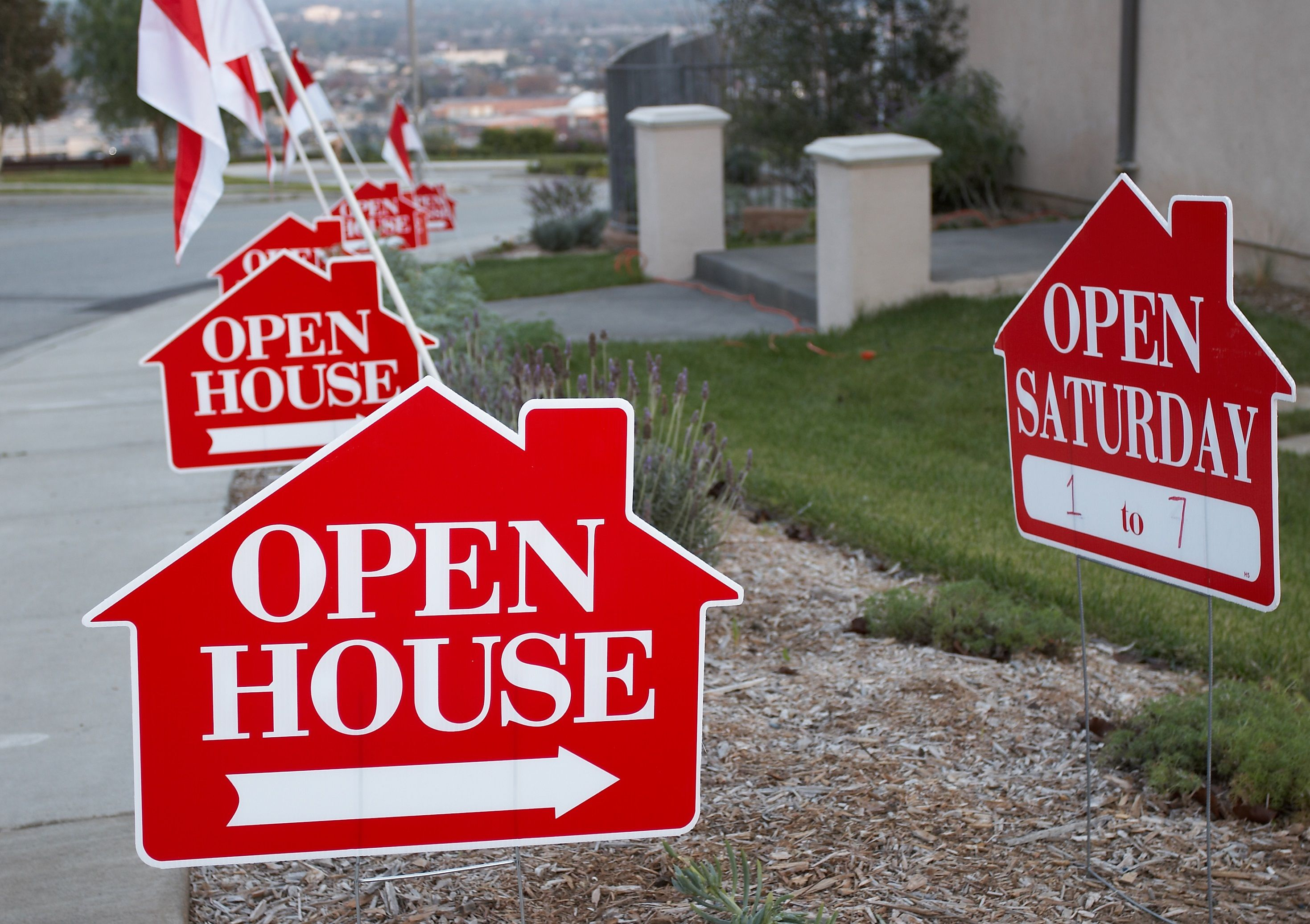 Red open house signs
