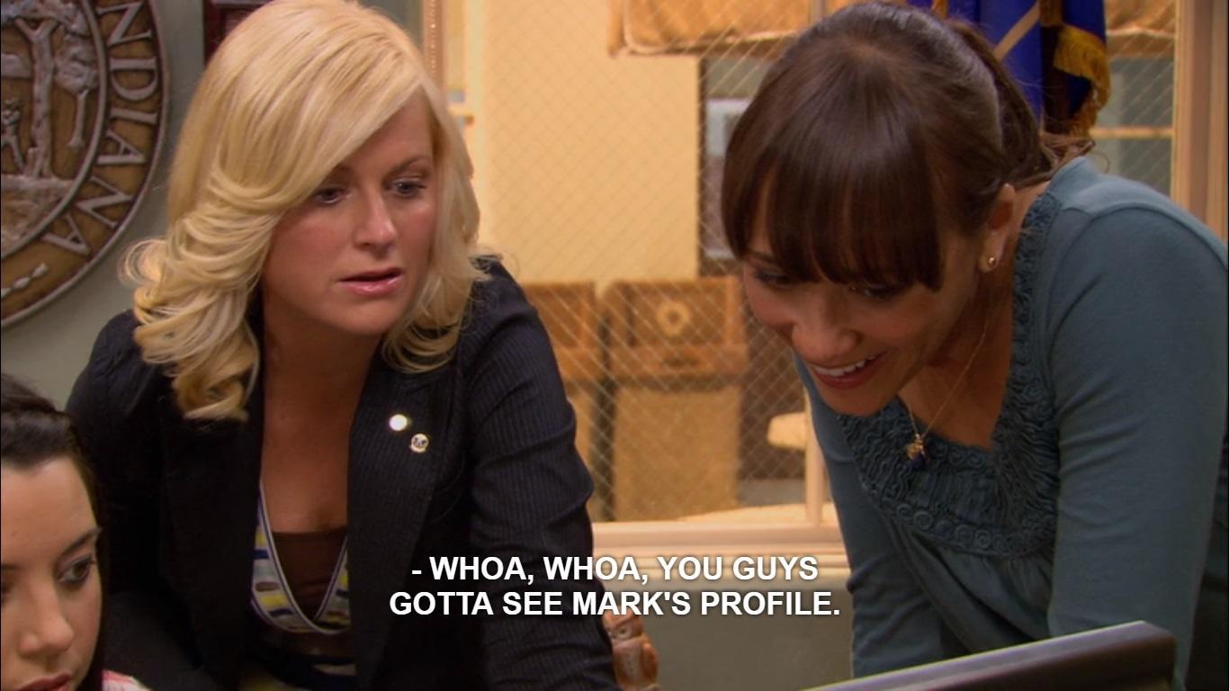 Leslie Knope looking at Facebook