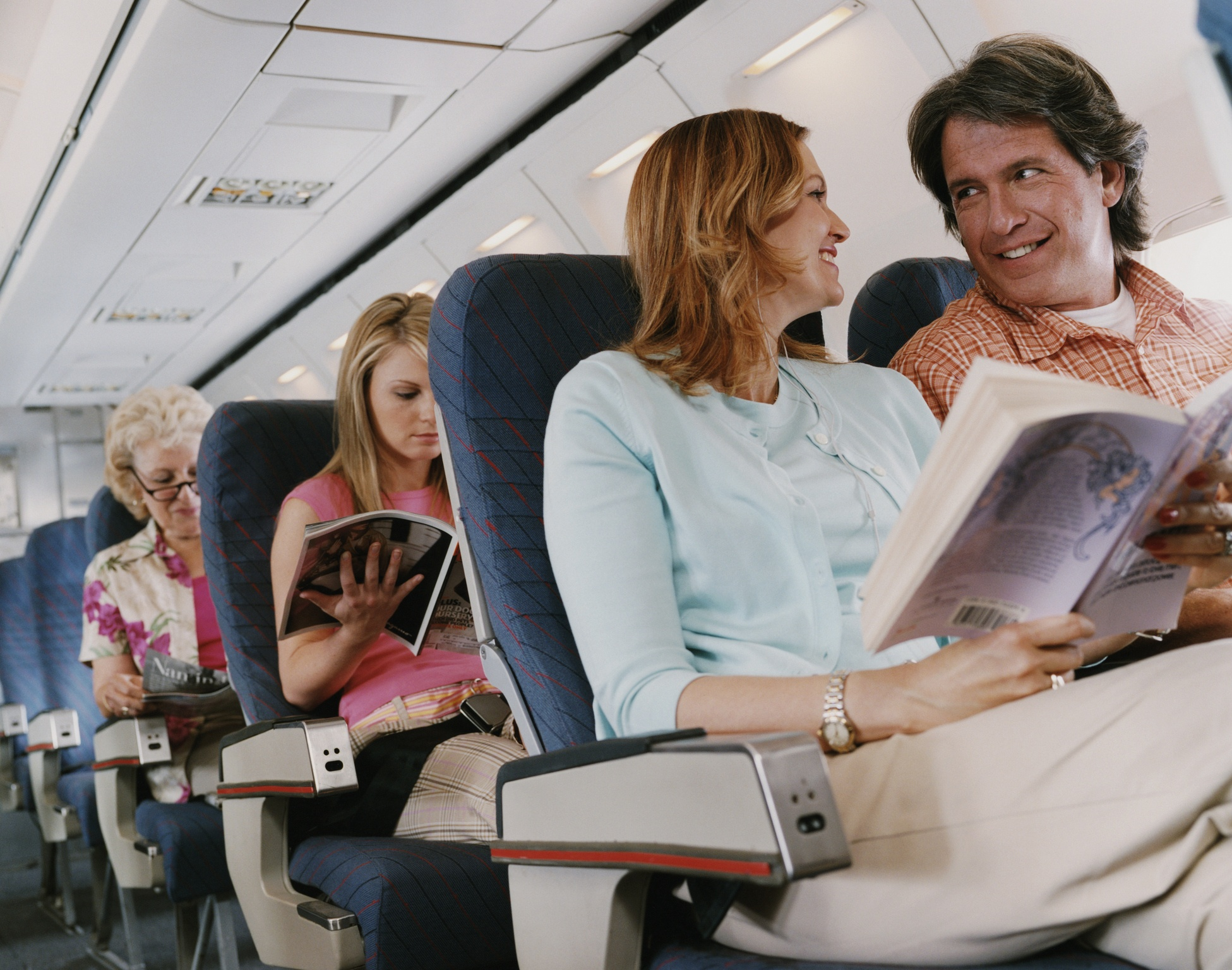 Couple talking on an airplane