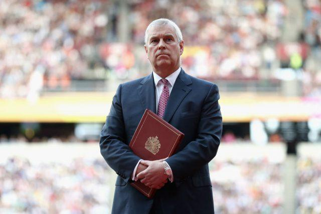 Prince Andrew standing before a crowd during a ceremony.