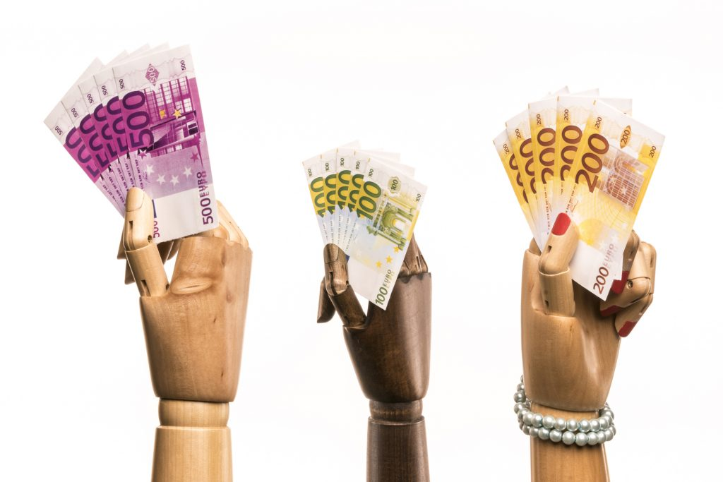 Wooden hands with money