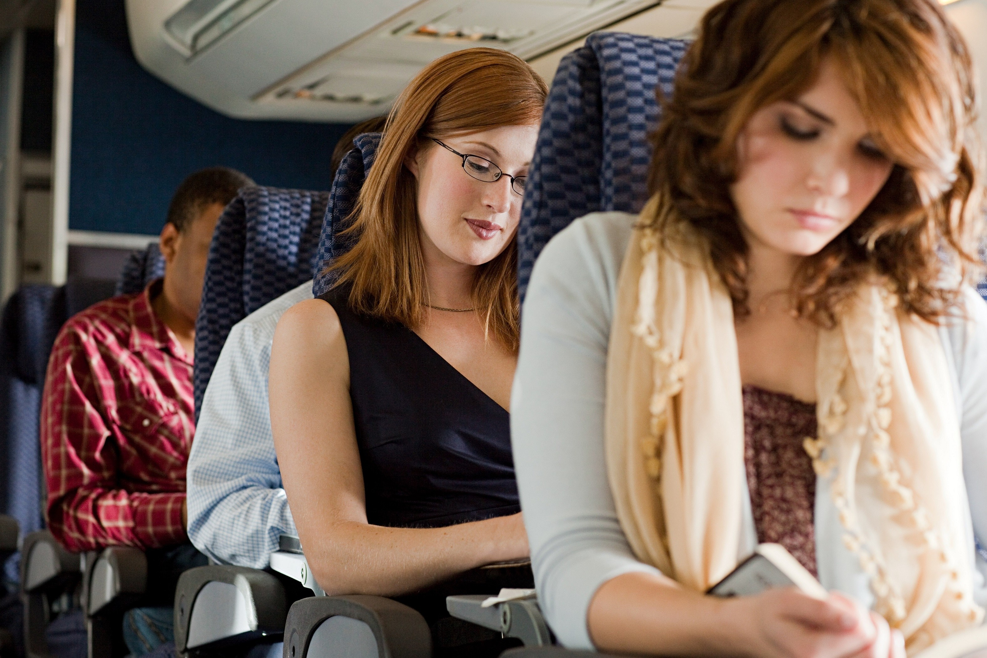 passengers reading on airplane