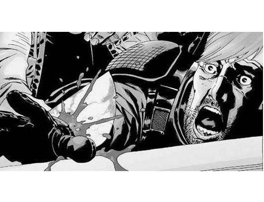 Stunned, Rick watches as the Governor cuts off his hand in 'The Walking Dead' comics.