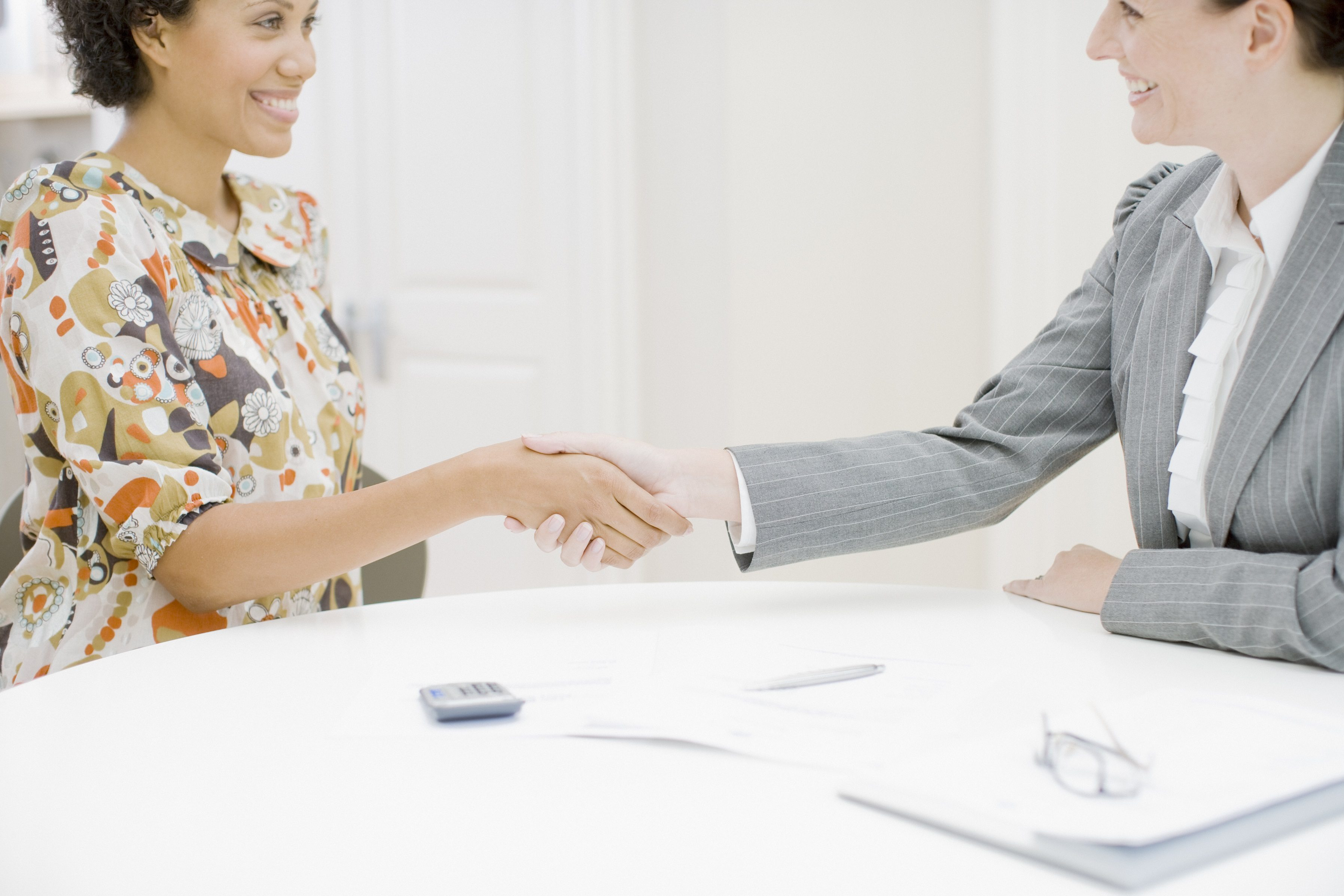 Sales woman shaking hands