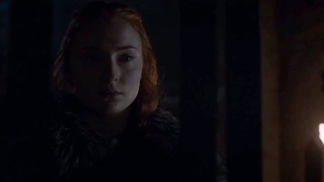Sansa Stark stares through the bars of a jail cell at Ramsay Bolton, offscreen, on 'Game of Thrones.'