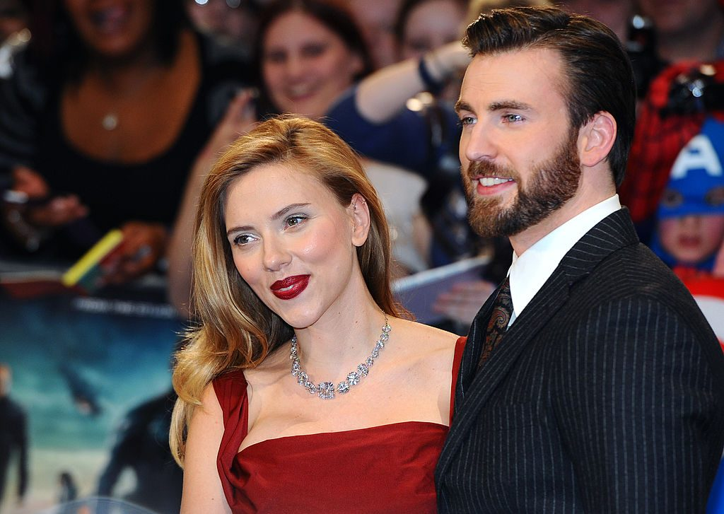 Scarlett Johansson and Chris Evans pose together on the red carpet