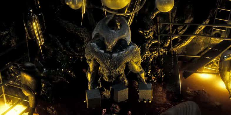 Steppenwolf holds three black boxes in his hands in Justice League