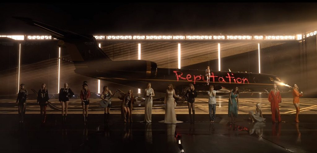 """Various versions of Taylor Swift standing in front of a plane with the word """"Reputation"""" on it"""