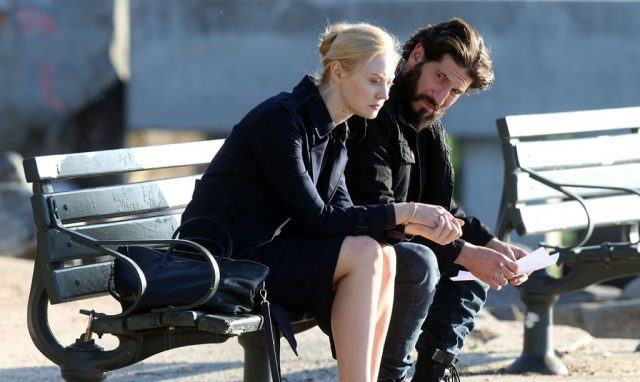 Deborah Ann Wolf and Jon Bernthal sitting on a bench in The Punisher