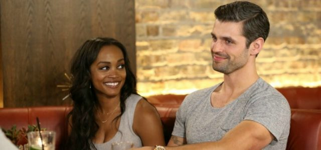 Peter Krause smiling as he sits next to Rachel Lindsay.
