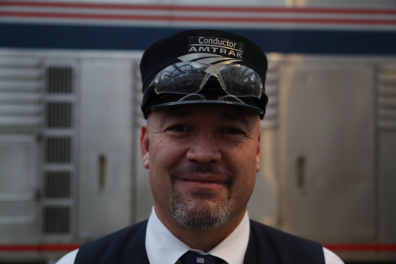 Male train conductor