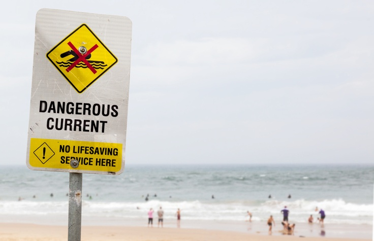 warning sign of dangerous current in ocean