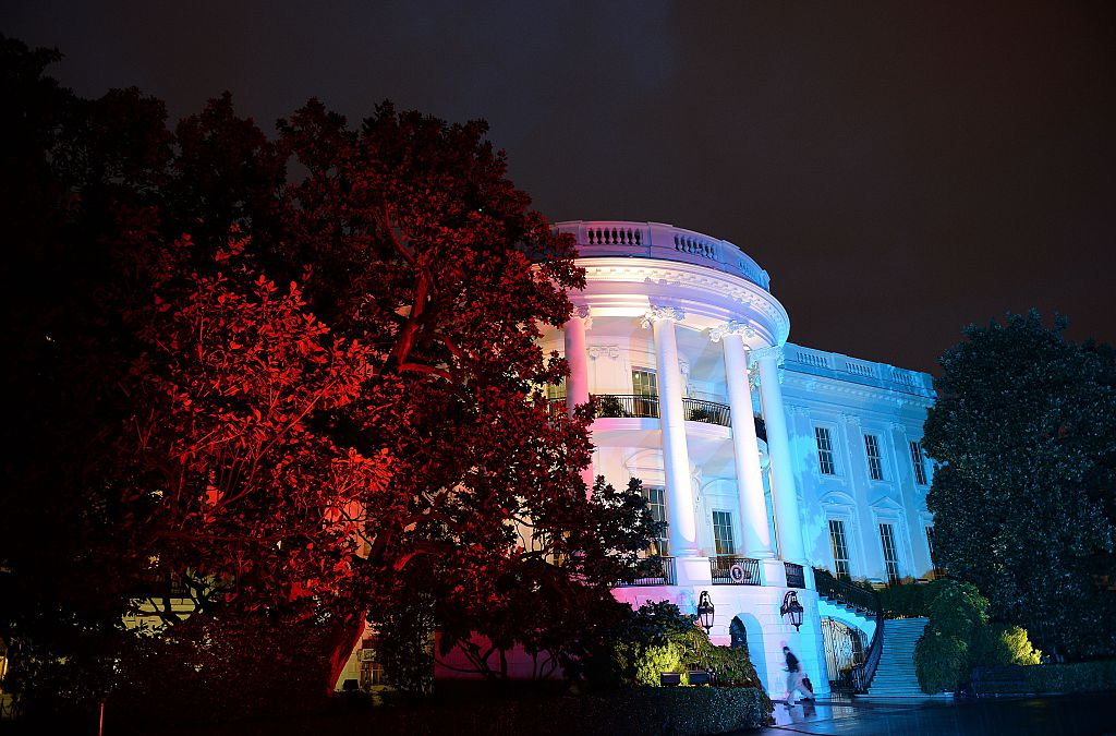 The White House illuminated in red, white and blue lights