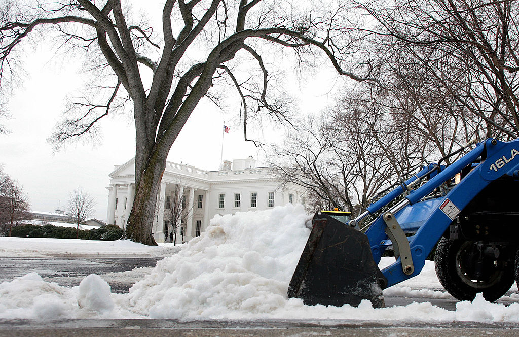 U.S. Park Service personnel clear the streets in front of the West Wing
