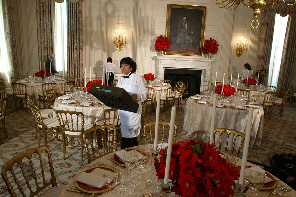 A kitchen staff member prepares the State Dining Room