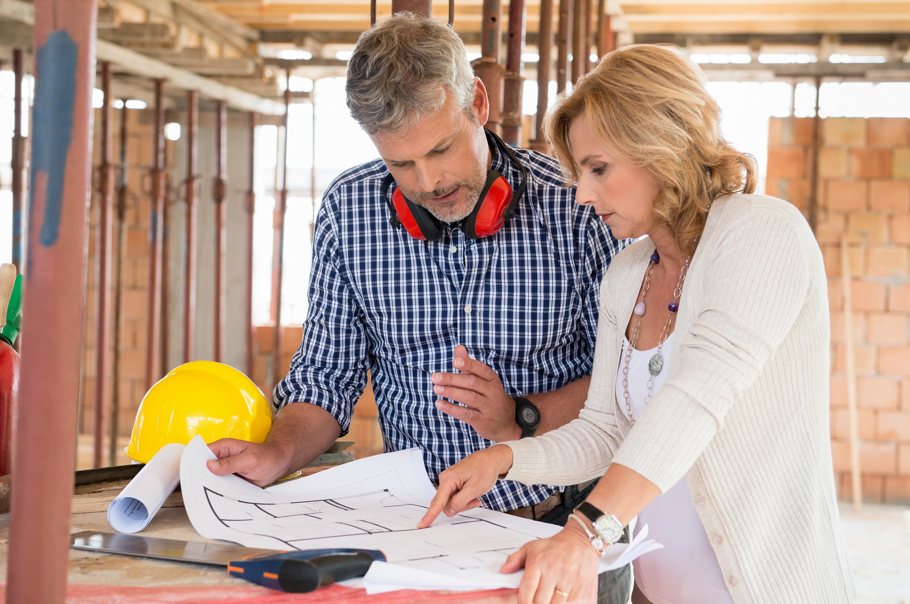 Man and woman discussing construction