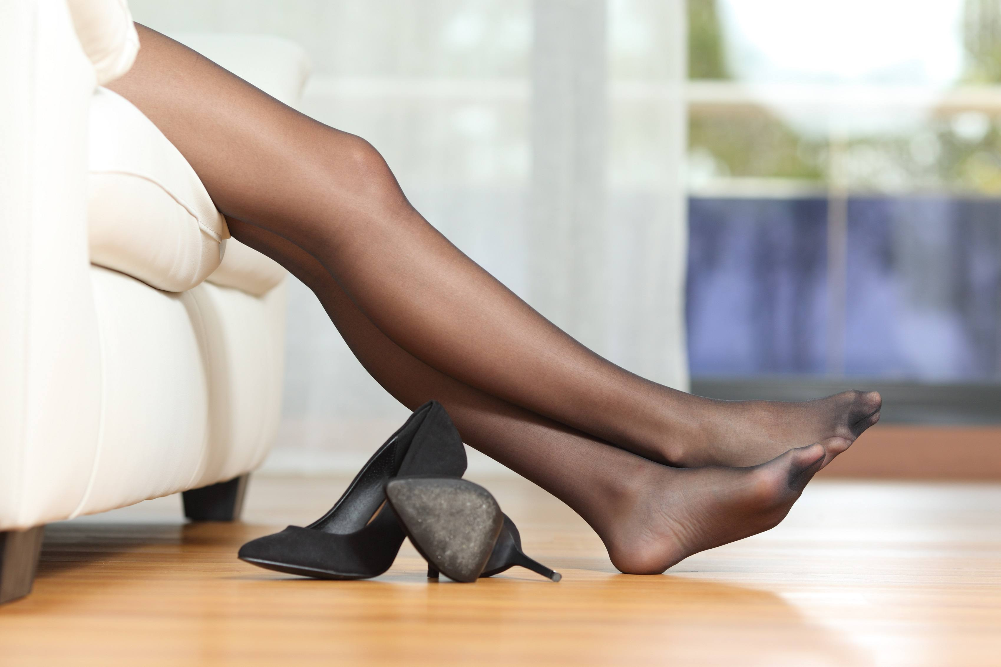 Woman stretching her legs out with tights