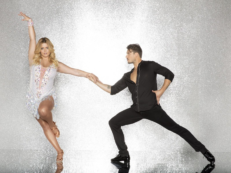 Sasha Pieterse and Gleb Savchenko pose against a white background