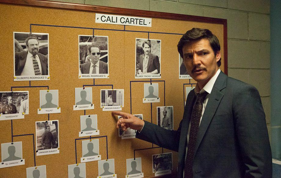 A man points to a bulletin board in Narcos Season 3