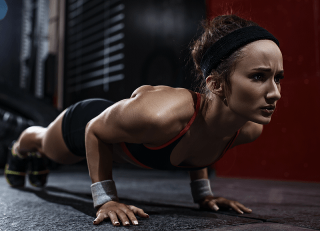 A woman in the middle of a plank pose.